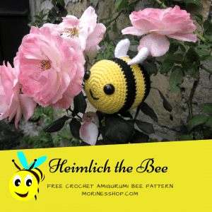 Crochet heimlich the bee perched on a rose branch