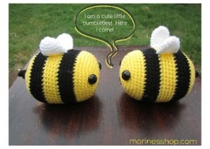 Two crochet bees facing each other