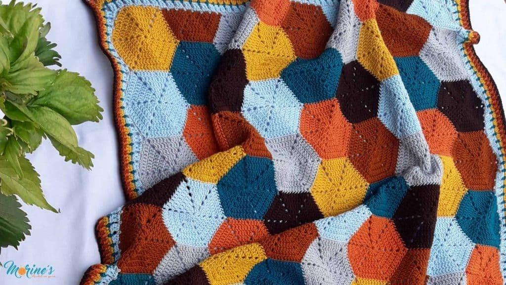 The Lexie Hexie Blanket pattern is a free crochet pattern that uses hexagon & half hexagon motifs to make a modern crochet baby blanket.