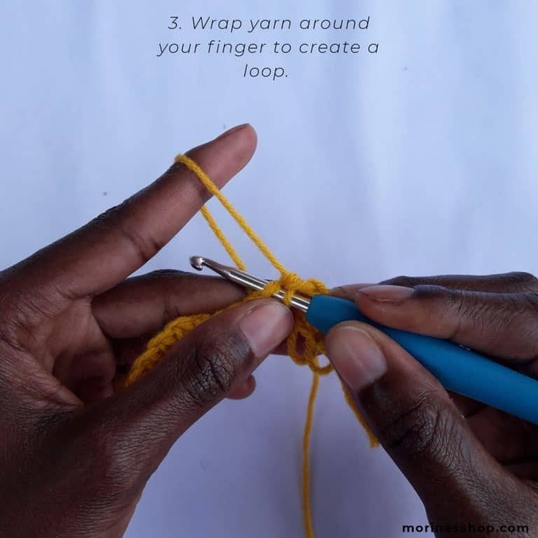 Wrap your finger around the yarn as shown