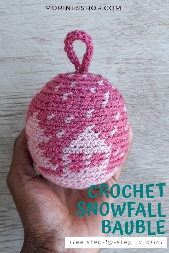 Make your own crochet ornaments this festive season with the Snowfall Bauble, a gorgeous free crochet Christmas bauble pattern #CrochetOrnaments #CrochetHoliday #HolidayDecor #CrochetDecorations #ChristmasCrochet