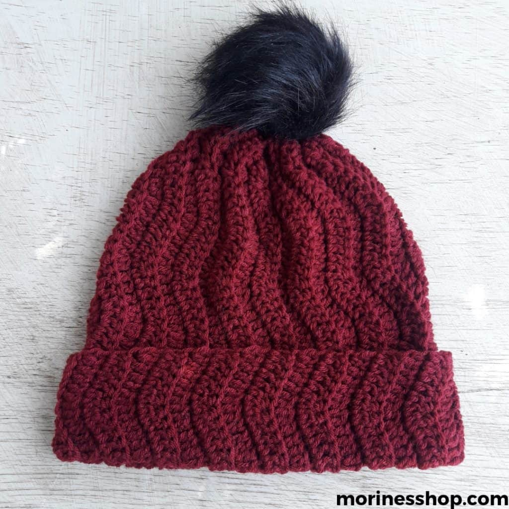The Twist to the Classic Beanie uses simple stitches with intervals of increases and decreases to give is a nice wavy effect. To add to that, the pattern is mostly worked in back loop only which adds a lovely ridged texture to it. This crochet beanie pattern is simple but unique and works up fast. Furthermore, it's easy to customize in terms of size, fit and colour.