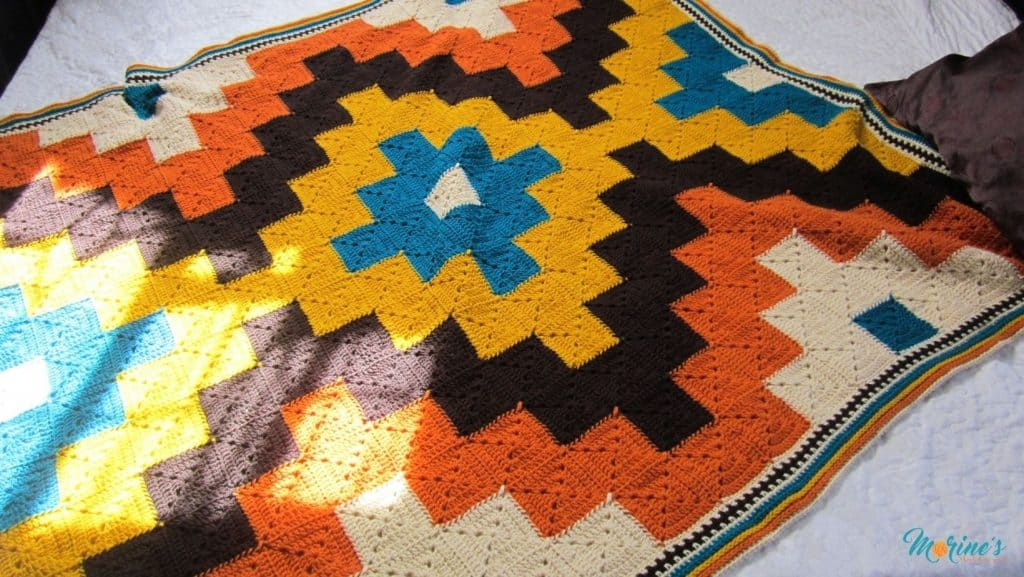 On the Spot  Throw is a crochet throw pattern that uses solid granny squares