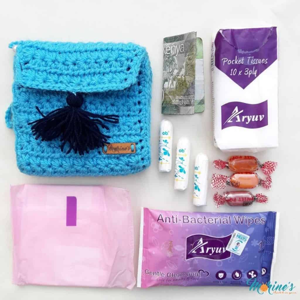 Crochet this gorgeous period pouch for your period essentials using the beautiful star stitch! A tutorial on how to add fabric lining is included! #CrochetPouch #PeriodPouch #StarStitch #CrochetBag #ModernCrochet #PeriodPositive