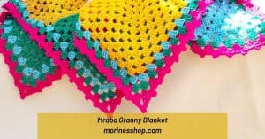 The Mraba Granny Blanket is made using the classic granny squares and perfect for anyone who wants to crochet a cheerful blanket #GrannySquareBlanket #ClassicGrannySquare #GrannySquare #CrochetGrannySquare #GrannySquarePattern